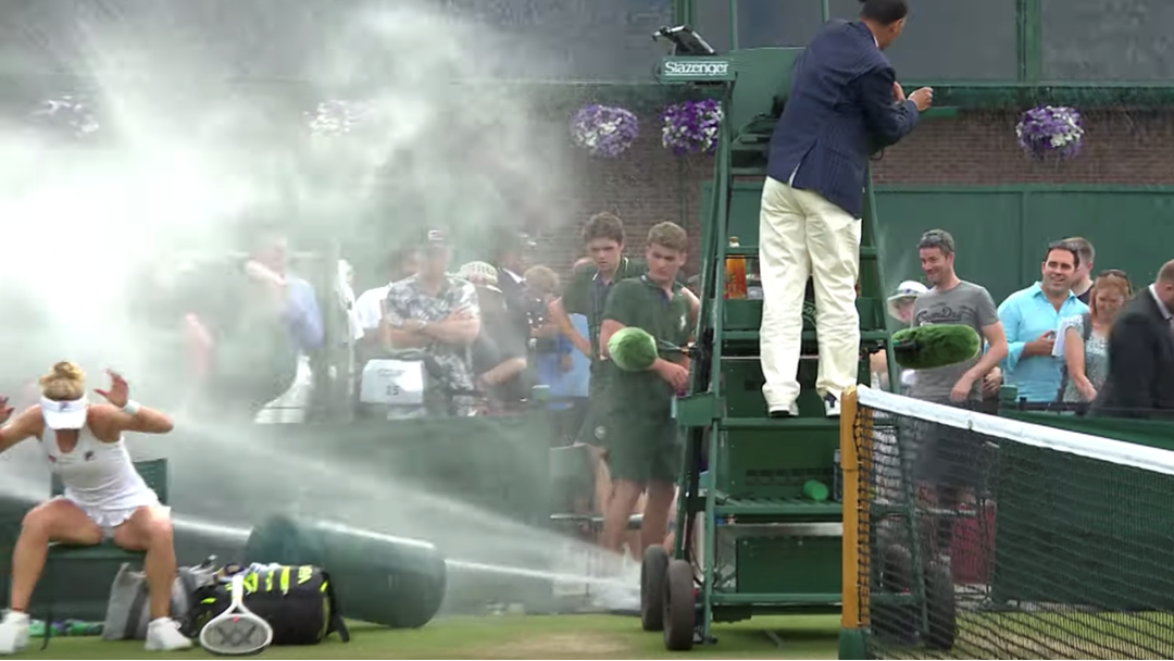 Article heading image for Tennis Players Literally Cop A Spray After Sprinkler System Goes Rogue At Wimbledon