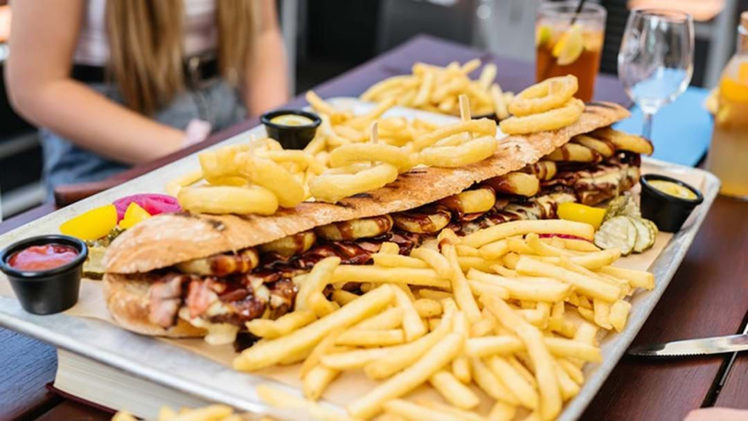 Article heading image for Stop Right Now, These Mega Two-Foot Sangas Exists With Bottomless Fries