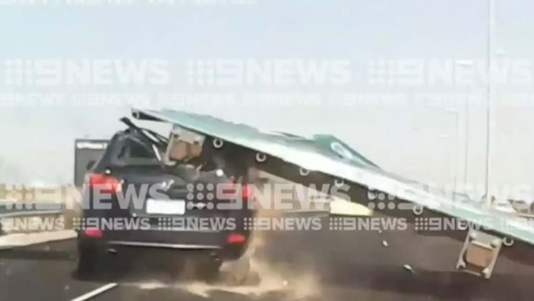 Article heading image for This Footage Of A Road Sign Falling On To A Car On A Melbourne Freeway Is Intense