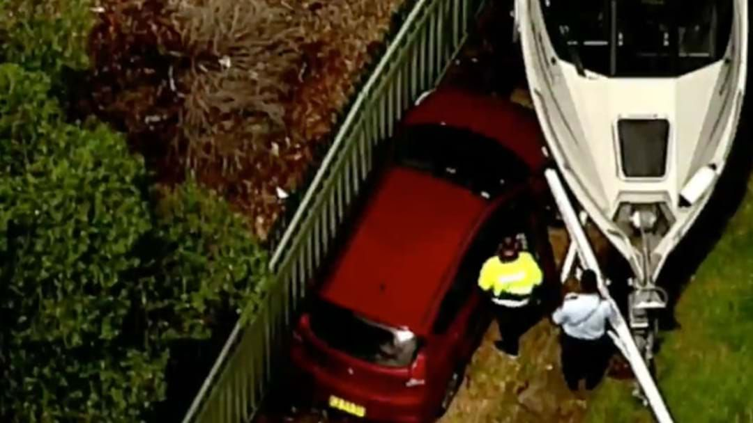 Article heading image for Paramedics Treating Elderly Man After Car Crashed Into Boat In Toongabbie