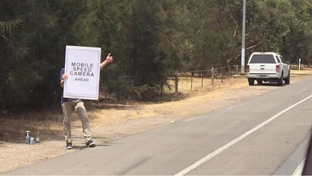 Article heading image for Aussie Bloke Spreading Christmas Cheer With His Speed Camera Warning Sign