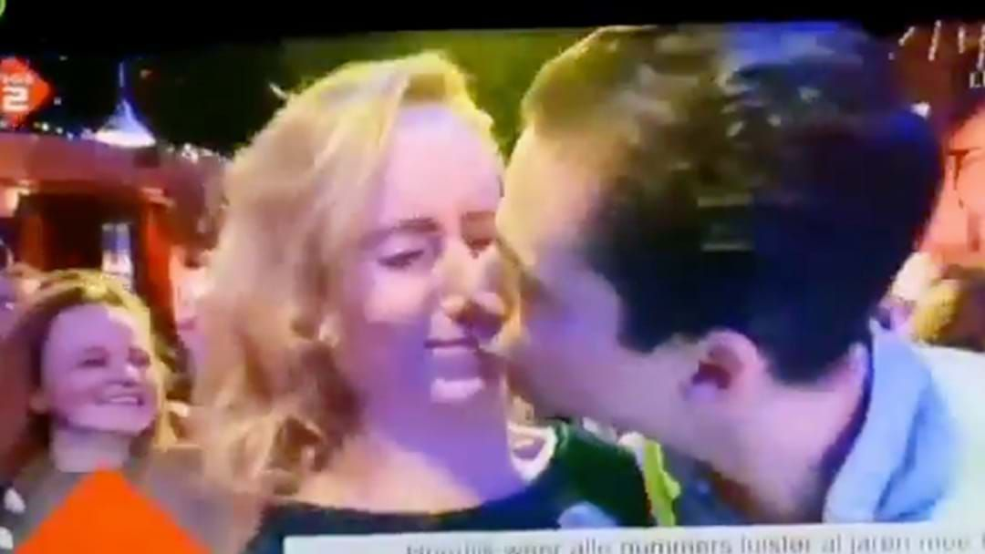 Article heading image for WATCH: Woman Savagely Rejects Bloke's New Year's Kiss On Live TV