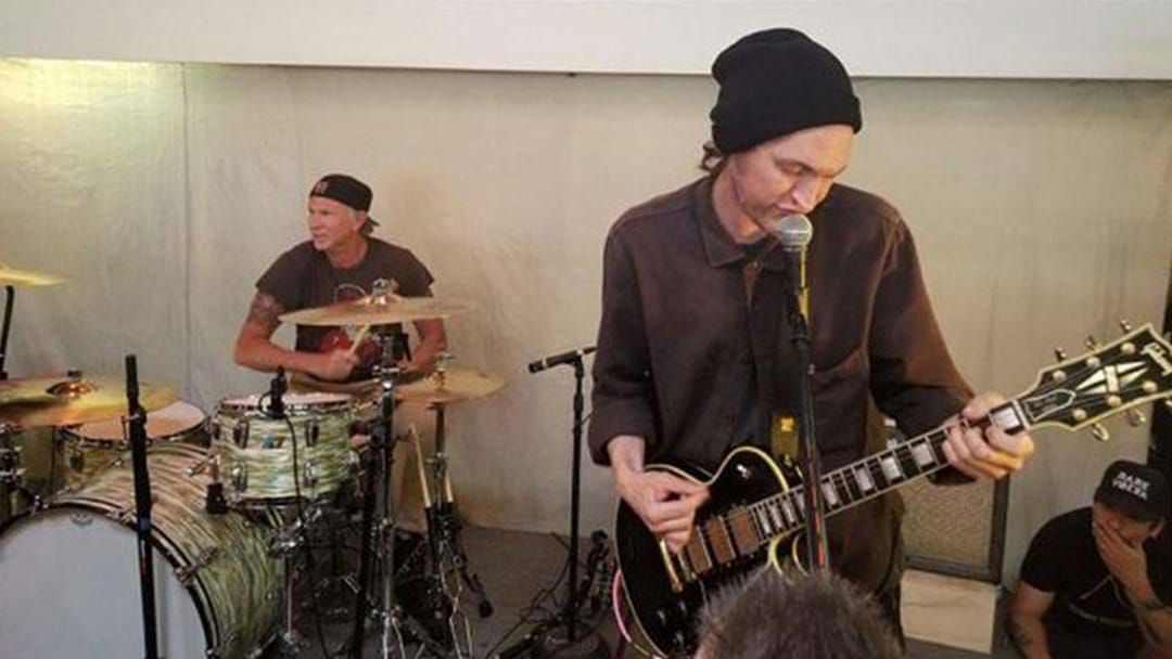 Article heading image for WATCH: Members Of Red Hot Chili Peppers Join Pearl Jam For Record Store Day Pop Up Gig