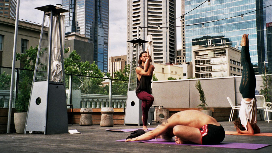 Article heading image for You Can Now Do Yoga On A Rooftop In Melbourne's CBD