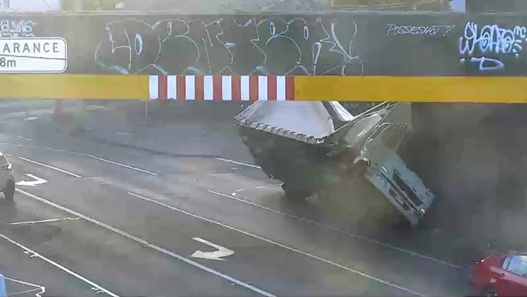 Article heading image for No Truck In Melbourne Is Safe: The City Road Rail Bridge Has Laid Waste To Another Truck This Morning