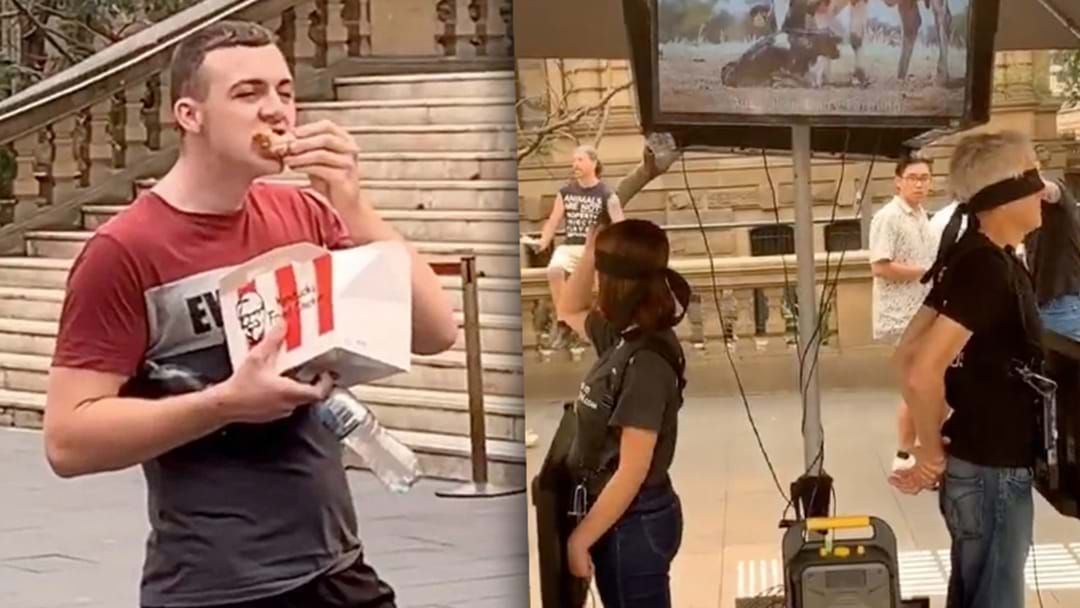 Article heading image for Bloke Feasts On KFC Wicked Wings During Vegan Protest At Sydney's Town Hall