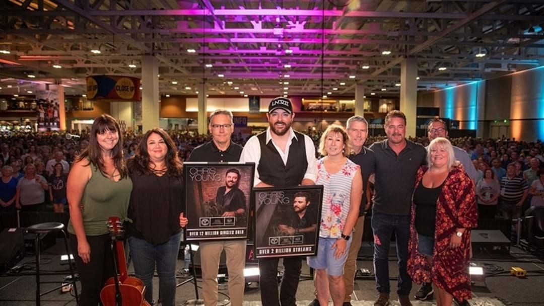 Article heading image for Chris Young Surprised with Plaques Commemorating 2 Billion Streams and 12 Million Singles Sold