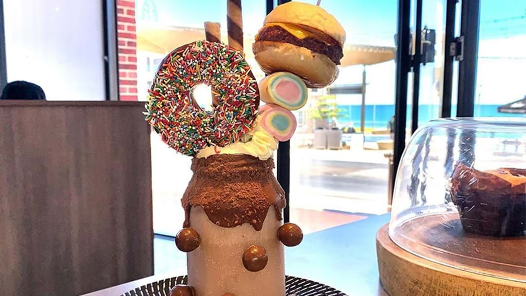 Article heading image for Yes, This Milo Thickshake Is Topped With An Actual Doughnut And Burger