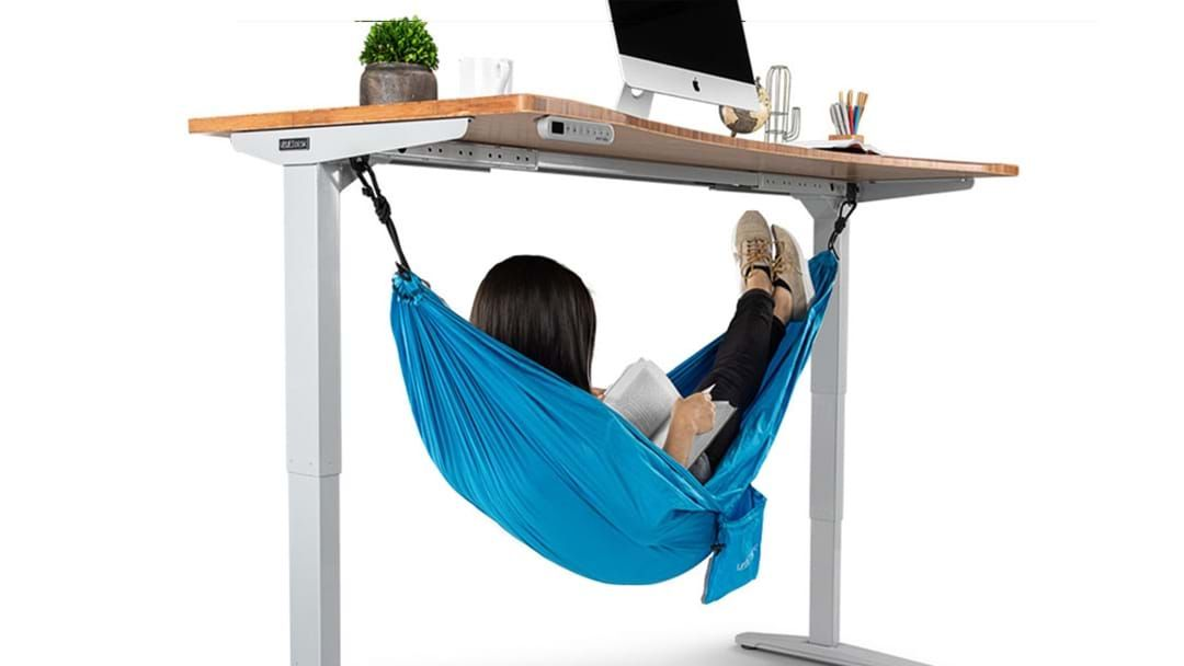 Article heading image for This Desk Hammock Will Let You Nap On Your Break!