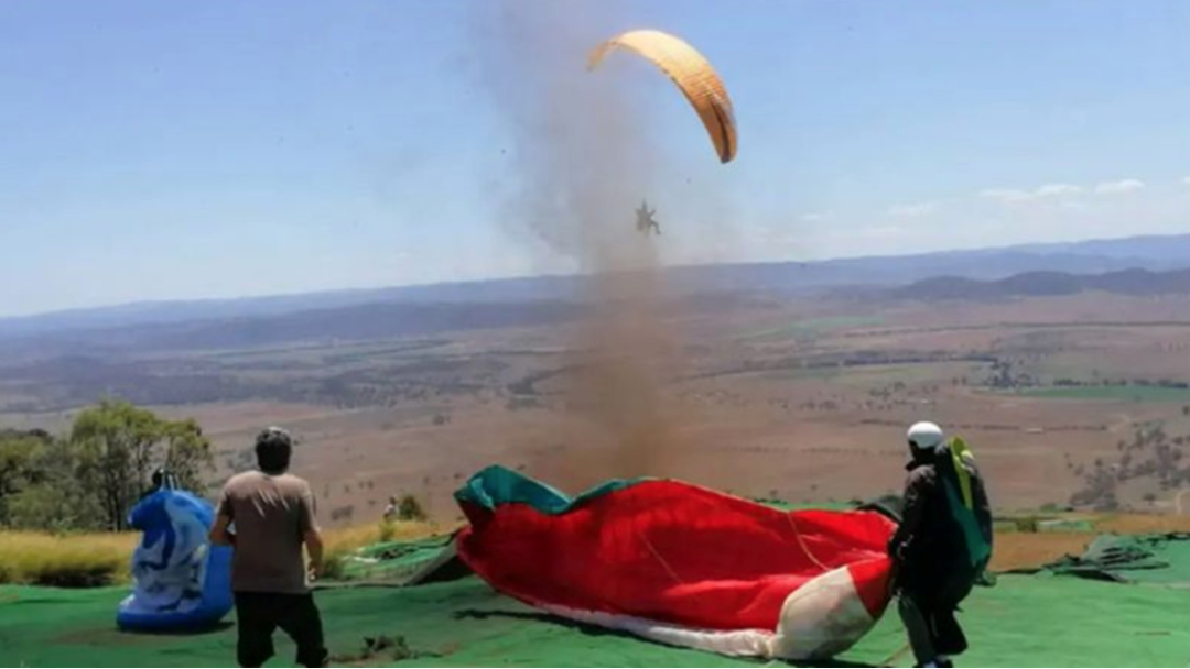Article heading image for WATCH | Paraglider Picked Up And Blown Through The Air For FIVE Hours After Small Dust Tornado