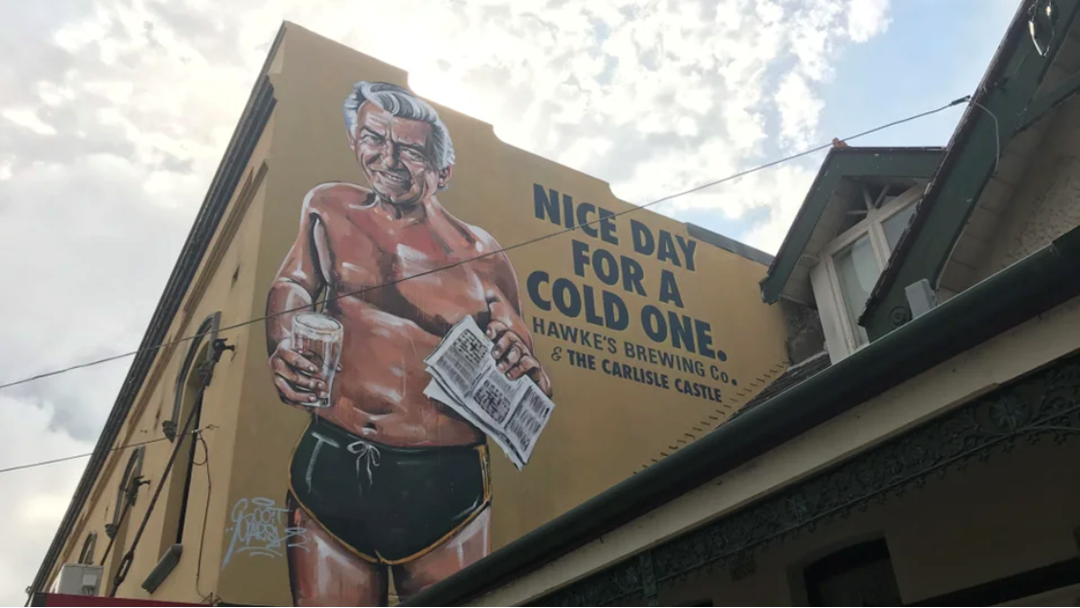 Article heading image for A Pub In Sydney Has Unveiled A Bloody Enormous Mural Of A Shirtless Bob Hawke