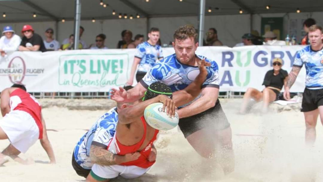 Article heading image for Beach Rugby Is Coming To Townsville, So Stretch Your Baby Cows Now