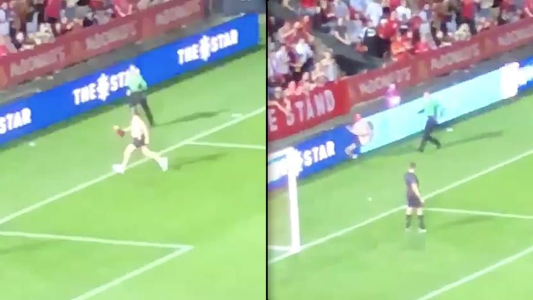 Article heading image for WATCH | Streaker Absolutely Stacks It, Crashes Into The Fence During FFA Cup Final