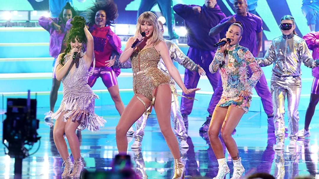 Article heading image for Taylor Swift Stuns In Iconic AMAs Performance With Camila Cabello And Halsey