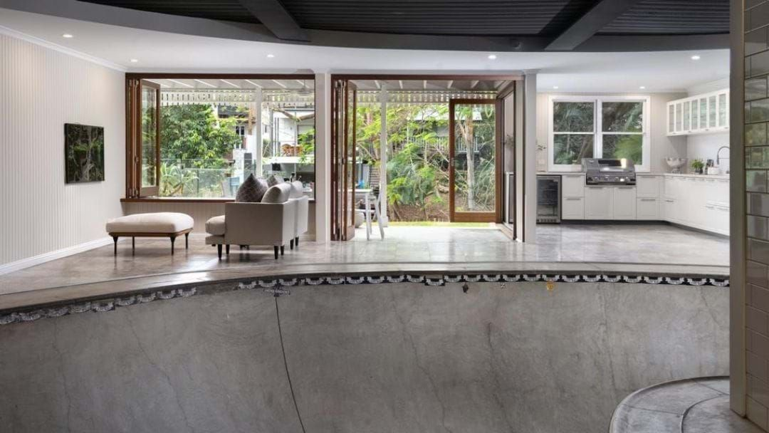 Article heading image for A Brisbane Home With An Indoor Skate Bowl Is Up For Grabs, But It's Not The Only Novelty House Out There