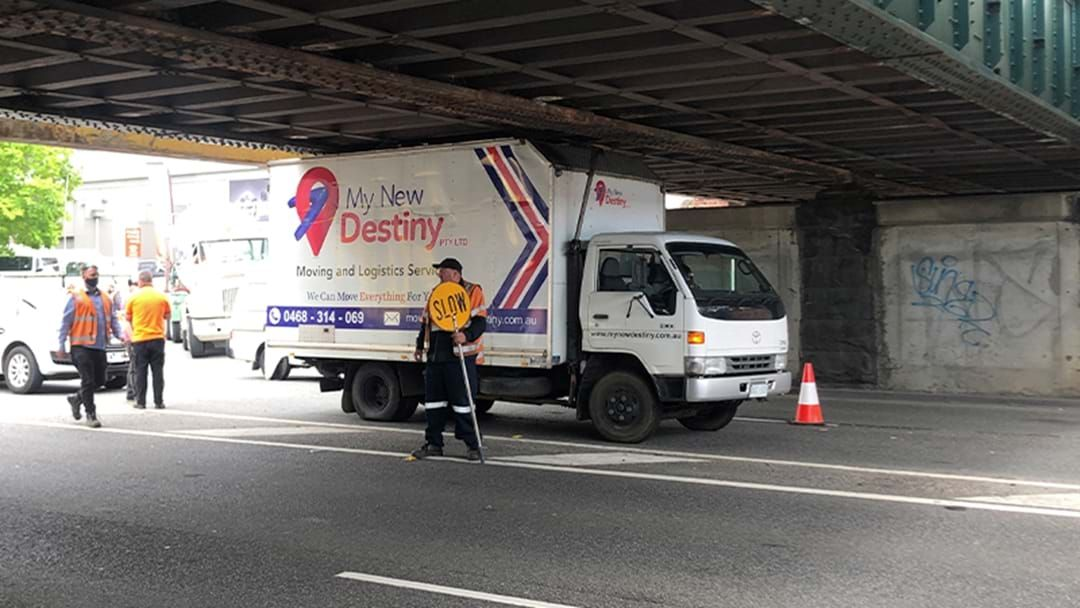 Article heading image for Melbourne Is Back: A Truck Has Wedged Itself Under The Montague St Bridge