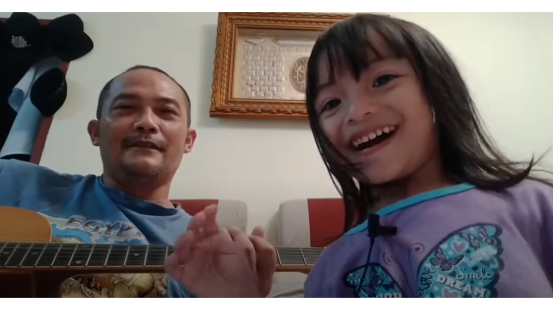 Article heading image for Best Dad Ever Teaches Toddler To Sing 'Killing In The Name' And Even Tom Morello Loves It
