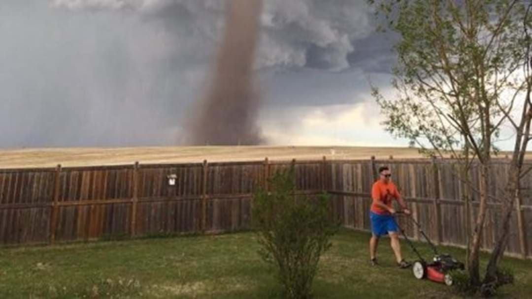 Article heading image for Man Cuts Grass While Tornado Tears Past